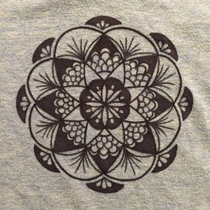 hand drawn black fan mandala on teal shirt