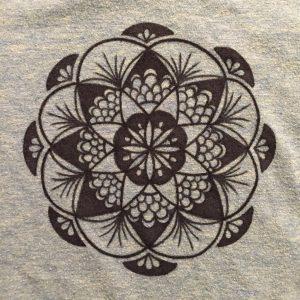 hand drawn black fan mandala on teal shirt