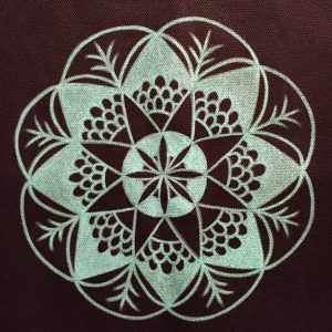 hand drawn teal mandala on black canvas tote bag