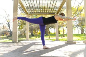 yoga pose balancing on one leg arms extended