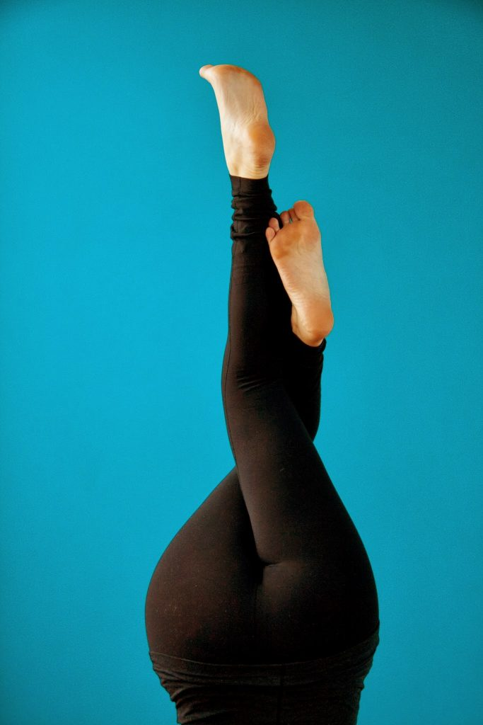 headstand with twisted legs