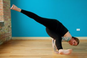 arm balance with legs split in the air