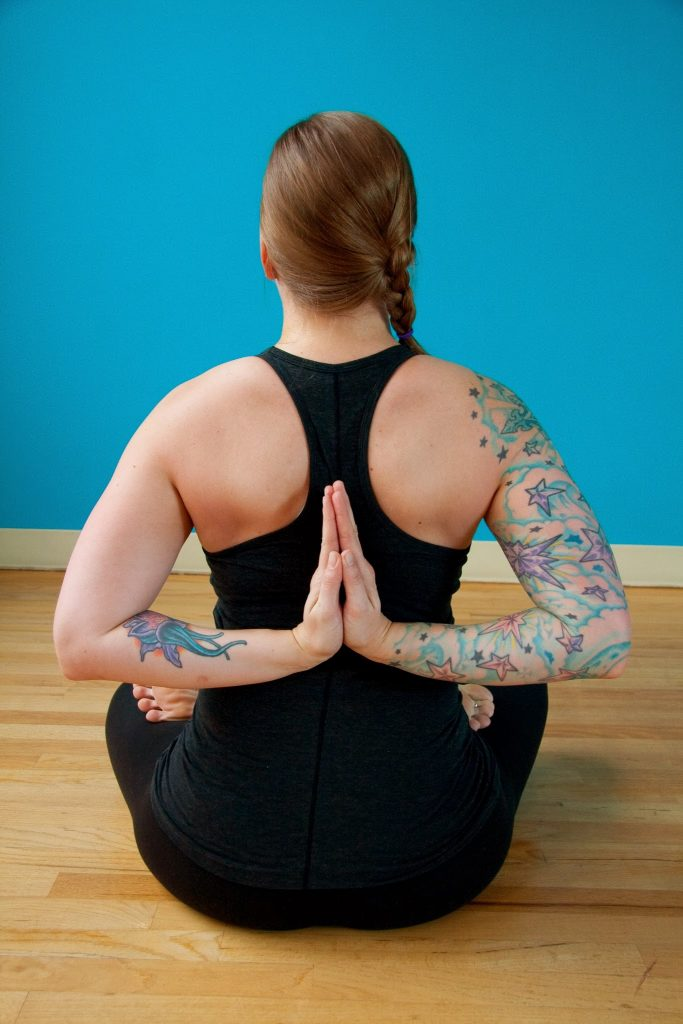 lotus posture with reverse prayer hands