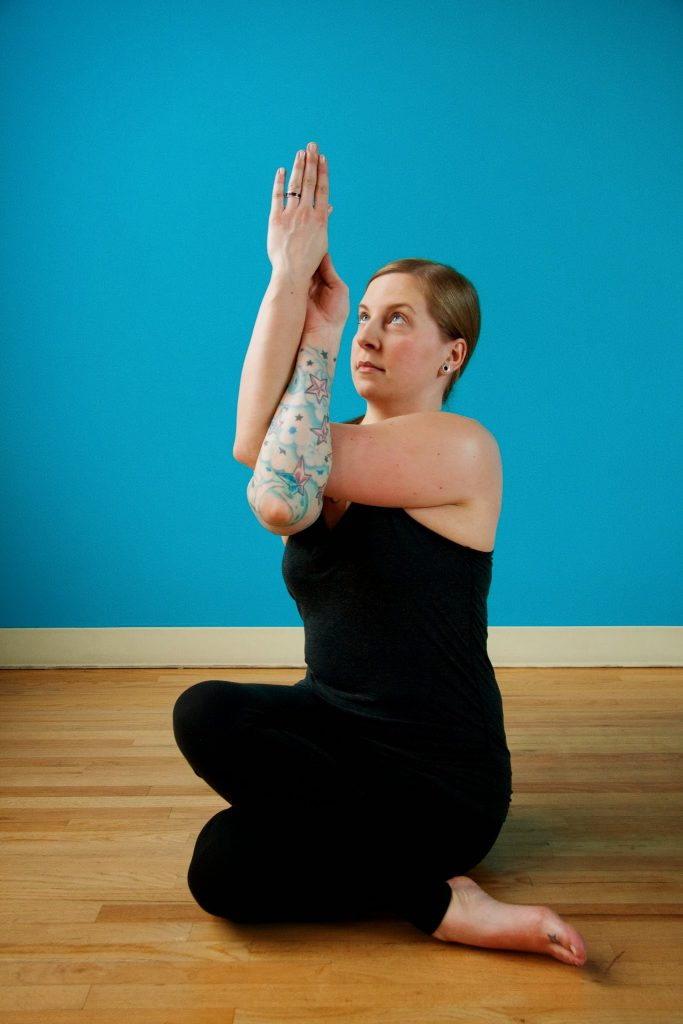 legs folded posture with arms wrapped around each other