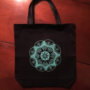 hand drawn teal mandala on black canvas tote bag