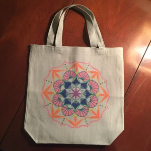 Hand drawn orange, blue and pink mandala on grey tote bag
