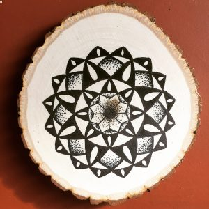 black ink teardrop mandala on wood