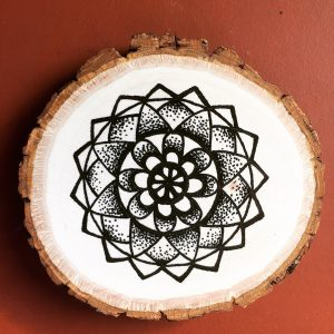 black ink flower mandala on wood