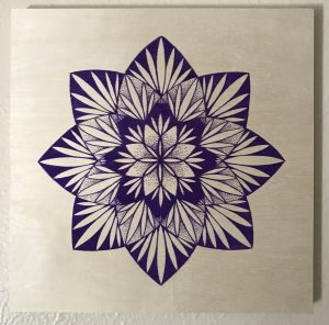 purple ink pen on 12 x 12 wooden panel